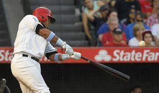 Los Angeles Angels' Luis Valbuena hits a three-run home run during the seventh inning of a baseball game against the Kansas City Royals, Saturday, June 17, 2017, in Anaheim, Calif. (AP Photo/Mark J. Terrill)