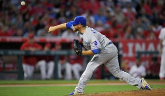 Kansas City Royals starting pitcher Ian Kennedy throws to the plate during the fourth inning of a baseball game against the Los Angeles Angels, Friday, June 16, 2017, in Anaheim, Calif. (AP Photo/Mark J. Terrill)