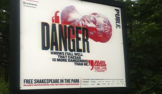 "In this June 7, 2017 photo, ""Danger knows full well that Caesar is more dangerous than he,"" reads a sign promoting The Public Theater's production of Julius Caesar in New York's Central Park. Police say they arrested a woman during the Friday, June 16, performance, and charged her with criminal trespass and disorderly conduct for getting up on stage and disrupting the play. (AP Photo/Verena Dobnik)"