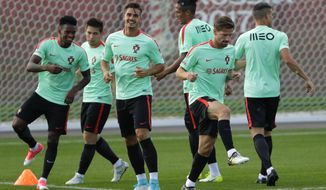 Portugal players practice drills during an official training session at the Rubin Training Ground in Kazan, Russia, on Friday, June 16, 2017. Portugal will play Mexico in the Confederations Cup, Group A soccer match scheduled for Sunday, June 18, 2017. (AP Photo/Sergei Grits)