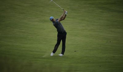 Martin Kaymer, of Germany, hits a shot on the 17th hole during the second round of the U.S. Open golf tournament Friday, June 16, 2017, at Erin Hills in Erin, Wis. (AP Photo/Charlie Riedel)