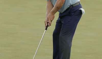 Charley Hoffman makes a birdie putt on the fifth hole during the third round of the U.S. Open golf tournament Saturday, June 17, 2017, at Erin Hills in Erin, Wis. (AP Photo/A Charlie Riedel)