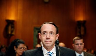 Deputy Attorney General Rod Rosenstein is leading the Russia probe. if Mr. Rosenstein recuses himself from the case, Associate Attorney General Rachel Brand would take over. (Associated Press)