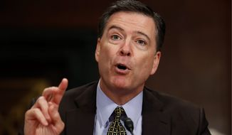 In this May 3, 2017, file photo, then-FBI Director James Comey testifies on Capitol Hill in Washington, before a Senate Judiciary Committee hearing. (AP Photo/Carolyn Kaster, File)