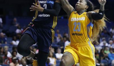 Indiana Fever guard Tiffany Mitchell, left, drives to the basket past Chicago Sky guard Cappie Pondexter during the second half of a WNBA basketball game Sunday, June 18, 2017, in Rosemont, Ill. (AP Photo/Nam Y. Huh)