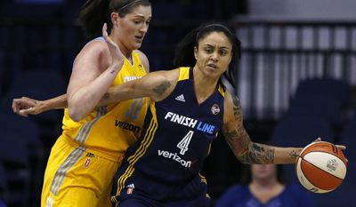 Indiana Fever forward Candice Dupree, right, drives against Chicago Sky center Stefanie Dolson during the first half of a WNBA basketball game Sunday, June 18, 2017, in Rosemont, Ill. (AP Photo/Nam Y. Huh)