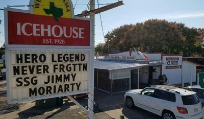 This Nov. 2016 photo shows a tribute from the Ice House drive-thru liquor store in Houston, Texas to 27-year-old Staff Sgt. James F. Moriarty, who died along with two other Green Berets in a Jordanian air base on Nov. 4, 2016 in circumstances that remain unclear. (AP photo courtesy of James Moriarty)