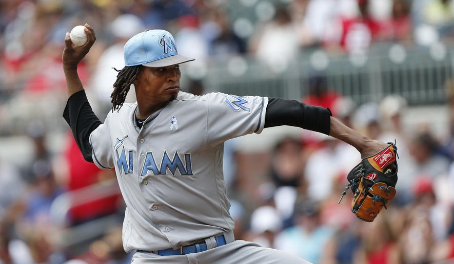 Miami Marlins starting pitcher Jose Urena (62) works in the first inning of a baseball game against the Atlanta Braves, Sunday, June 18, 2017, in Atlanta. (AP Photo/John Bazemore)