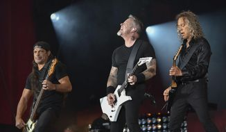 "FILE - In this Sept. 24, 2016, file photo, musicians Robert Trujillo, left, James Hetfield and Kirk Hammett of Metallica perform at the 2016 Global Citizen Festival in Central Park in New York. Metallica joined Jimmy Fallon and The Roots for a toy instrument rendition of its hit, ""Enter Sandman,"" in a segment that aired on ""The Tonight Show"" on Nov. 16, 2016. (Photo by Evan Agostini/Invision/AP, File)"