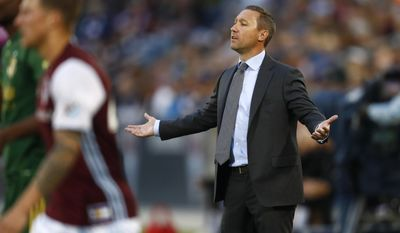 Portland Timbers head coach Caleb Porter pleads with referees for a call while facing the Colorado Rapids in the first half of an MLS soccer match Saturday, June 17, 2017, in Commerce City, Colo. (AP Photo/David Zalubowski)