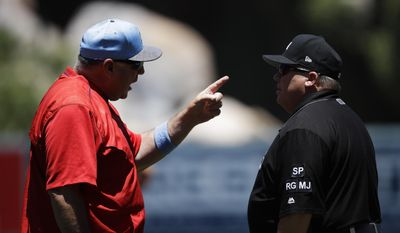 Los Angeles Angels manager Mike Scioscia, left, argues with first base umpire Fieldin Culbreth after Kole Calhoun's hit was ruled a double during the first inning of a baseball game against the Kansas City Royals, Sunday, June 18, 2017, in Anaheim, Calif. (AP Photo/Jae C. Hong)