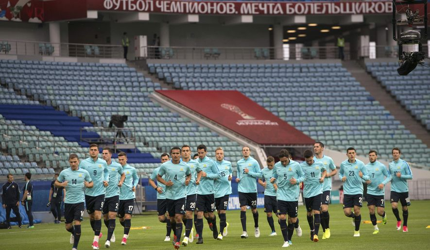 Australia's team exercise during a training session at the Fisht stadium in Sochi, Russia, on Sunday, June 18, 2017. Australia will face Germany in a Confederations Cup, Group B soccer match scheduled Monday, June 19, 2017. (AP Photo/Artur Lebedev)