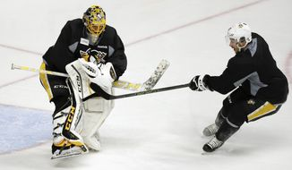 FILE - In a Sunday, June 4, 2017, file photo, Pittsburgh Penguins goalie Marc-Andre Fleury, left, blocks a shot by center Sidney Crosby during a practice, in Nashville, Tenn. Three-time Stanley Cup champion goalie Fleury, Nashville forward James Neal and Anaheim defenseman Sami Vatanen are among the high-profile players available for the Vegas Golden Knights to select in the NHL expansion draft on Wednesday, June 21, 2017.  (AP Photo/Mark Humphrey, File)