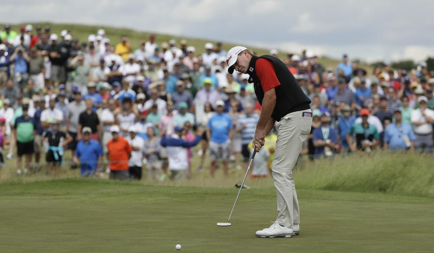 Steve Stricker putts on the ninth hole during the fourth round of the U.S. Open golf tournament Sunday, June 18, 2017, at Erin Hills in Erin, Wis. (AP Photo/David J. Phillip)