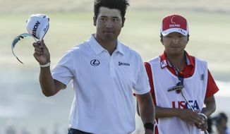 Hideki Matsuyama, of Japan, acknowledges the crowd on the 18th hole during the fourth round of the U.S. Open golf tournament Sunday, June 18, 2017, at Erin Hills in Erin, Wis. (AP Photo/David J. Phillip)