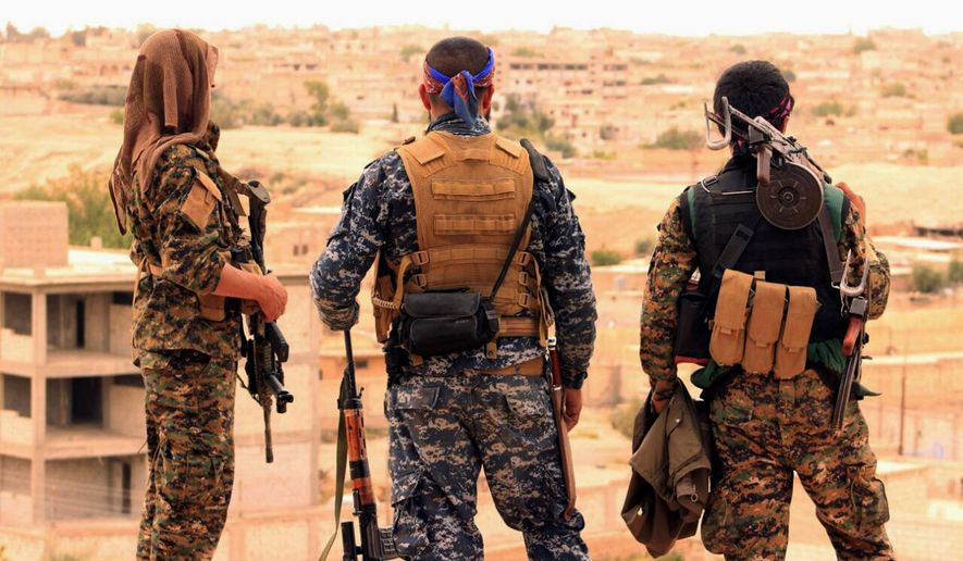 Fighters from the Syrian Democratic Forces (SDF) looked toward the northern town of Tabqa, Syria, where the city, its dam and its airfield were the coalition objectives this spring. The battle served as an example of how delegations of authority made a difference in speed of execution. (Associated Press/File)