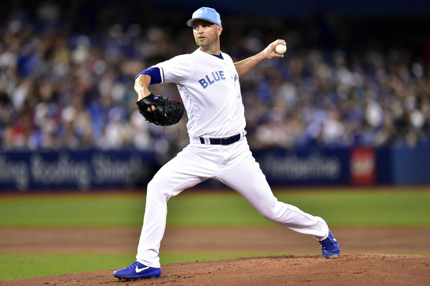 Toronto Blue Jays starting pitcher J.A. Happ throws to the Chicago White Sox during first-inning baseball game action in Toronto, Sunday, June 18, 2017.(Frank Gunn/The Canadian Press via AP)