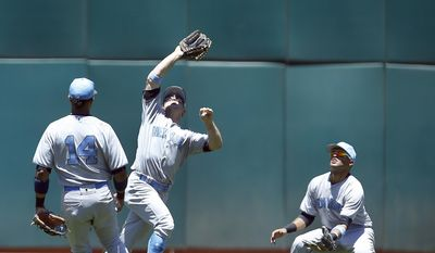 New York Yankees left fielder Brett Gardner, center, makes a catch on a pop up fly ball between second baseman Starlin Castro (14) and center fielder Mason Williams, right, during the second inning against the Oakland Athletics in a baseball game on Sunday, June 18, 2017 in Oakland, Calif. (AP Photo/Tony Avelar)