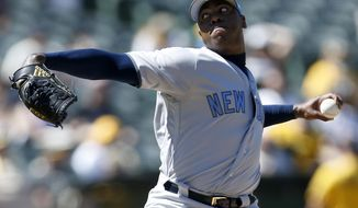 New York Yankees pitcher Aroldis Chapman (54) throws against the Oakland Athletics during the eighth inning of a baseball game on Sunday, June 18, 2017 in Oakland, Calif. (AP Photo/Tony Avelar)
