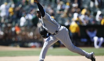 New York Yankees pitcher Aroldis Chapman throws against the Oakland Athletics during the eighth inning of a baseball game Sunday, June 18, 2017, in Oakland, Calif. (AP Photo/Tony Avelar)