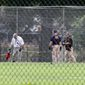 FBI agents searched for evidence on the baseball field in Alexandria, Virginia, where Republican lawmakers were attacked by a gunman. The frightening incident prompted some to call for easing local gun laws. (Associated Press)