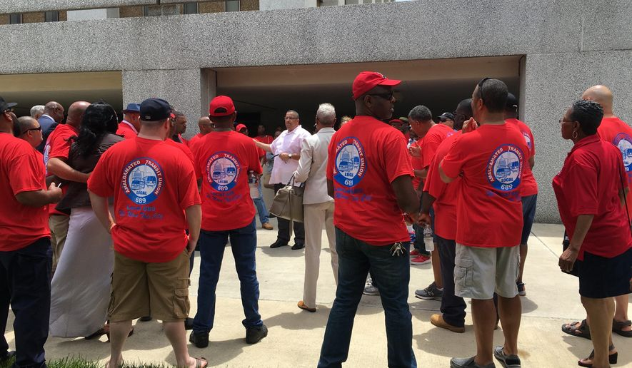 """Amalgamated Transit Union Local 689 members gather at the Prince George County Council meeting before presenting a """"Fund It, Fix It and Make It Fair"""" Metro proposal. (Photo by Sarah Nelson / The Washington Times)"""