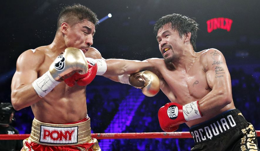 Manny Pacquiao, right, of the Philippines, hits Jessie Vargas during their WBO welterweight title boxing match, Saturday, Nov. 5, 2016, in Las Vegas. (AP Photo/Isaac Brekken)
