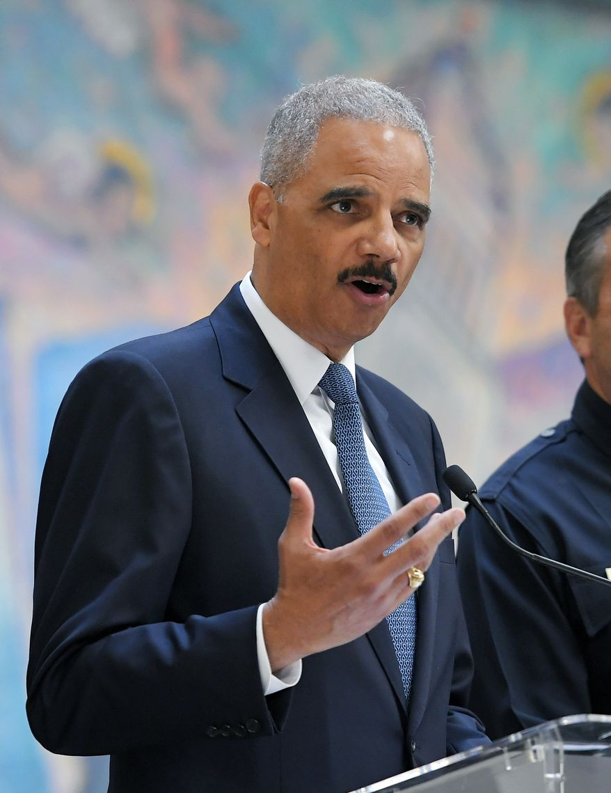 """Former U.S. Attorney General Eric Holder, speaks at a news conference to discuss the proposed so-called California """"sanctuary state bill"""", Monday, June 19, 2017, in Los Angeles. (AP Photo/Mark J. Terrill) ** FILE **"""