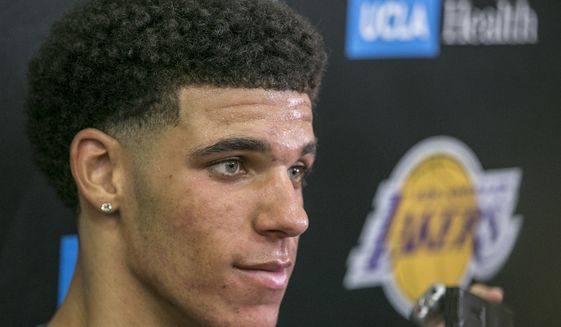FILE - In this June 7, 2017, file photo, University of California Los Angeles guard Lonzo Ball takes questions from the media after a closed Los Angeles Lakes pre-draft workout in El Segundo, Calif. Ball's mental steadiness is one big reason he's almost certain to be a top-three pick at the NBA Draft on Thursday. (AP Photo/Damian Dovarganes, File)