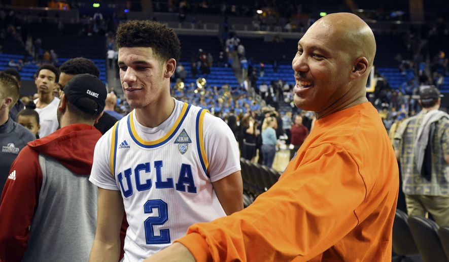 In this Nov. 20, 2016, file photo, UCLA's Lonzo Ball (2) walks by his father LaVar Ball, right, to greet family members after UCLA defeated Long Beach State in an NCAA college basketball game in Los Angeles.  By now the entire basketball world knows Lonzo Ball is a singular talent with a unique parent.  (AP Photo/Michael Owen Baker, File)