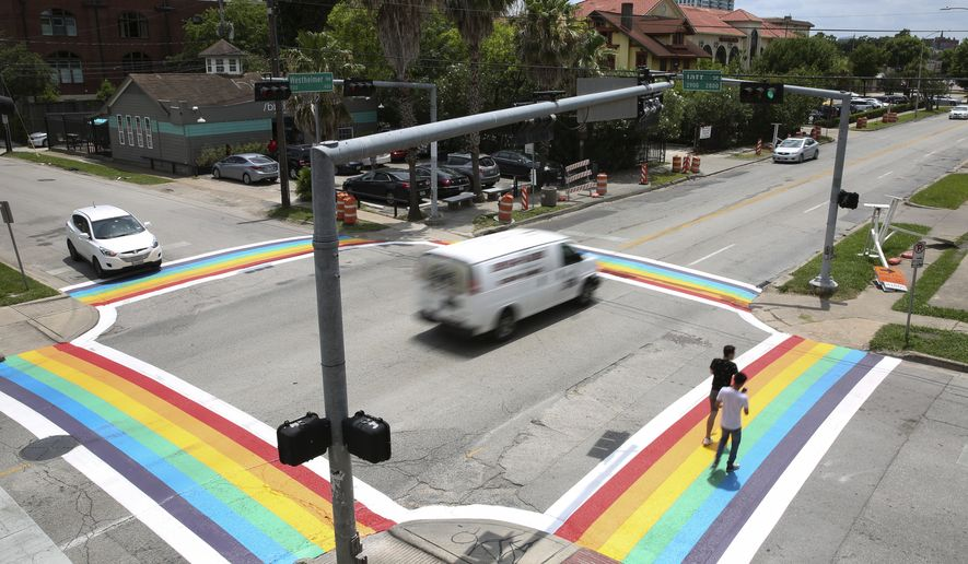 The completed four Rainbow Flag crosswalks at the intersection of Westheimer Road and Taft Street have became a popular spot for photographs Sunday, June 18, 2017, in Houston. (Yi-Chin Lee/Houston Chronicle via AP)