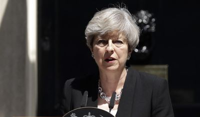 Britain's Prime Minister Theresa May speaks to the media outside 10 Downing Street in London, Monday, June 19, 2017. A driver plowed into a crowd of Muslim worshippers outside a north London mosque early Monday in an attack that police said they were investigating as a terrorist incident. (AP Photo/Matt Dunham)