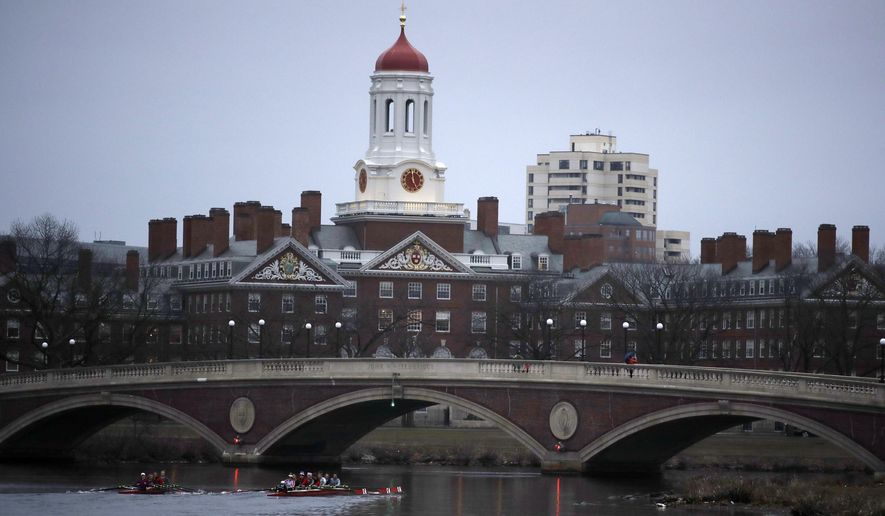 In this March 7, 2017 file photo, rowers paddle down the Charles River near the campus of Harvard University in Cambridge, Mass. (AP Photo/Charles Krupa, File)