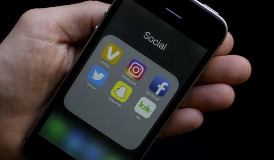 This June 16, 2017, photo shows social media app icons on a smartphone held by an Associated Press reporter in San Francisco. (Associated Press) **FILE**