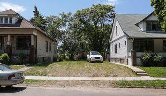 This is the lot where Daniel Murray's family home once stood, June 2, 2017. The Detroit Land Bank Authority had it torn down. (Ryan Garza/Detroit Free Press vi AP)
