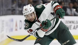FILE - In this Jan. 7, 2017, file photo, Minnesota Wild defenseman Matt Dumba shoots during the third period of an NHL hockey game against the Los Angeles Kings, in Los Angeles. The Golden Knights could land Dumba in their expansion draft on Wednesday, June 21. (AP Photo/Chris Carlson, File)