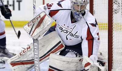 FILE - In this Sunday, Feb. 19, 2017, file photo, Washington Capitals goalie Philipp Grubauer defends the net during the second period of an NHL hockey game against the New York Rangers in New York. The Vegas Golden Knights GM might as well be The Godfather of the NHL during a three-day expansion draft window. The expansion draft rules made it so that Vegas would wind up with strong enough goaltending to be competitive even in its inaugural season. There's also a surplus of young goaltending talent, including Detroit's Petr Mrazek, Washington's Grubauer, the New York Rangers' Antti Raanta and Colorado's Calvin Pickard. (AP Photo/Seth Wenig, File)