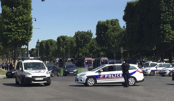 Police vehicles prevent the access to the Champs Elysees avenue in Paris, France, Monday, June 19, 2017. Paris officials say : Suspected attacker 'downed' after driving into police car on Champs-Elysees. (AP Photo/Bertrand Combaldieu)