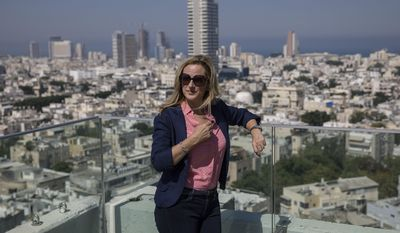 American Oscar winning actress Marlee Matlin poses during an interview to Associated Press on the rooftop of Tel Aviv municipality Monday, June 19, 2017. Matlin is in Israel to receive the prestigious Morton E. Ruderman Award for her lifelong activism for people with disabilities. (AP Photo/Tsafrir Abayov)