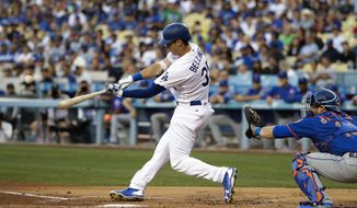 Los Angeles Dodgers' Cody Bellinger hits a three-run home run during the first inning of a baseball game against the New York Mets, Monday, June 19, 2017, in Los Angeles. (AP Photo/Jae C. Hong)