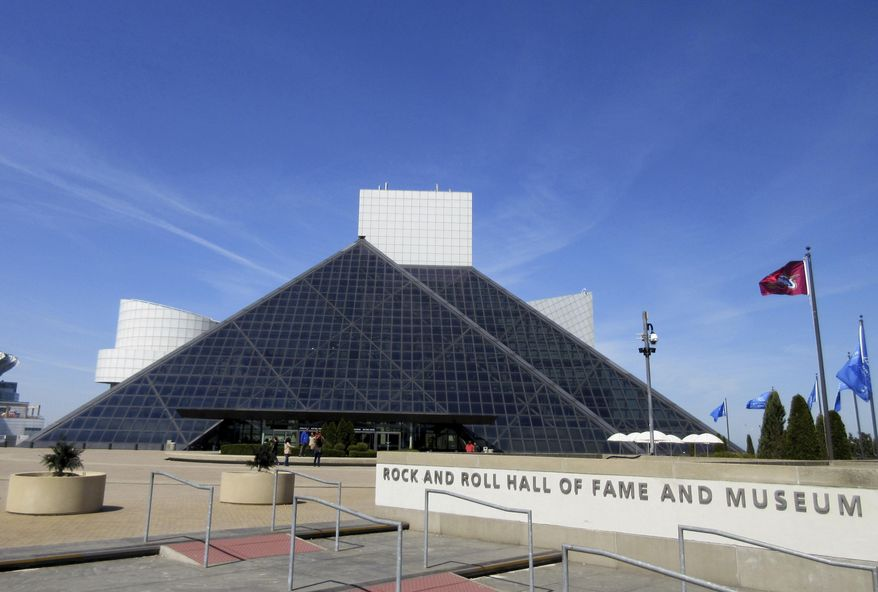 FILE – This April 24, 2016, file photo shows the Rock and Roll Hall of Fame and Museum, located on the shores of Lake Erie in downtown Cleveland. The Cleveland-based museum has announced plans to create a permanent presence in Tokyo. A short term exhibit will open in September 2017. (AP Photo/Beth J. Harpaz, File)