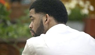 Dominique Heaggan-Brown listens to the statement he made to investigators after the shooting is read back to him in court by Special Agent Raymond Gibbs of the Wisconsin Department of Justice, Friday, June 16, 2017, in Milwaukee. Heaggan-Brown, a former Milwaukee police officer on trial in a fatal shooting that sparked riots in a predominantly black neighborhood, said Friday he will not testify, as his attorneys prepare to begin presenting his defense. (Michael Sears/Milwaukee Journal Sentinel via AP, Pool)