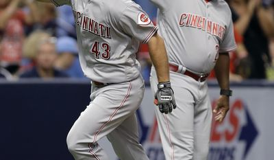 Cincinnati Reds' Scott Schebler (43) celebrates with third base coach Billy Hatcher after hitting a home run off Tampa Bay Rays starting pitcher Jake Odorizzi during the fifth inning of a baseball game Monday, June 19, 2017, in St. Petersburg, Fla. (AP Photo/Chris O'Meara)