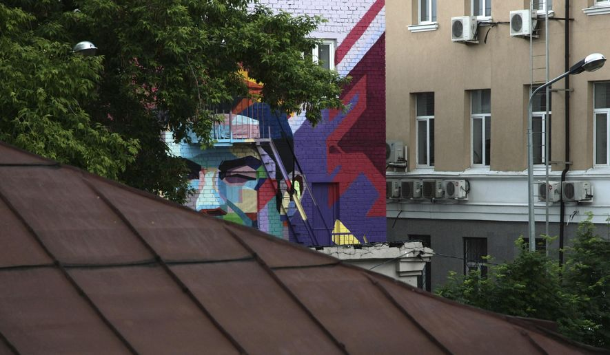 A mural of Portugal's Cristiano Ronaldo is partly seen painted on a house in Kazan, Russia, on Sunday, June 18, 2017. (AP Photo/Nikolay Alexandrov)