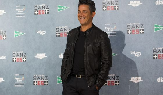 FILE - In a Wednesday, May 17, 2017 file photo, Spanish singer Alejandro Sanz poses for the media during a photo call at the Vicente Calderon stadium in Madrid. Sanz has been named 2017 Latin Recording Academy Person of the Year. The academy will honor the 18-time Latin Grammy Award winner and three-time Grammy Award winner on Nov. 15 at the Mandalay Bay Convention Center in Las Vegas, on the eve of the Latin Grammys.  (AP Photo/Francisco Seco, File)