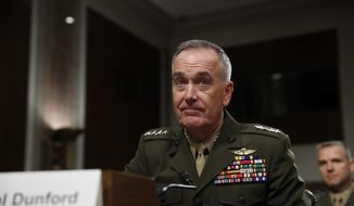 In this June 13, 2017, file photo, Joint Chiefs Chairman Gen. Joseph Dunford prepares to testify on Capitol Hill in Washington. Dunford said Monday, June 19, 2017, that Washington and Moscow are in delicate discussions to tamp down tensions arising from the U.S. shootdown of a Syrian fighter jet, which the Russians called a violation of a U.S.-Russian understanding on avoiding air incidents.  (AP Photo/Jacquelyn Martin, File)