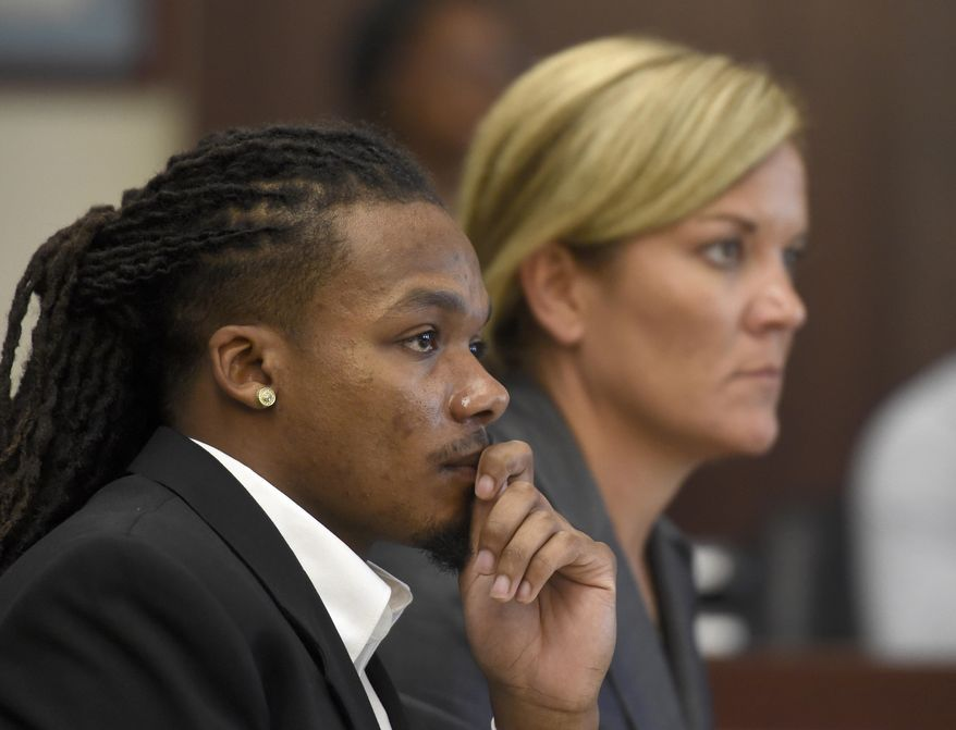 Brandon E. Banks and his attorney Katie Hagan listen during the Vanderbilt rape case trial at Justice A. A. Birch Building Monday, June 19, 2017, in Nashville, Tenn. Banks is charged with five counts of aggravated rape and two counts of aggravated sexual battery.  (Lacy Atkins/The Tennessean via AP, Pool)
