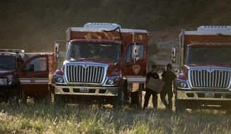 Firefighting crews get ready to roll out for the day on the fire line, Monday, June 19, 2017, to put out a wildfire burning north of the southern Utah ski town of Brian Head, Utah. Utah firefighters were battling a wildfire Monday that shut down a highway and forced hundreds of people to flee a ski town as crews in New Mexico mop up another blaze amid scorching heat in the Southwest U.S. (Leah Hogsten/The Salt Lake Tribune via AP)