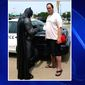 """Officer Damon Cole from Fort Worth, Texas, was entertaining children while dressed as Batman when he was called to a local Walmart to stop a shoplifting suspect, June 19, 2017. One of the items in the suspect's possession was a """"Lego Batman"""" DVD. (Fox-4 Texas screenshot)"""