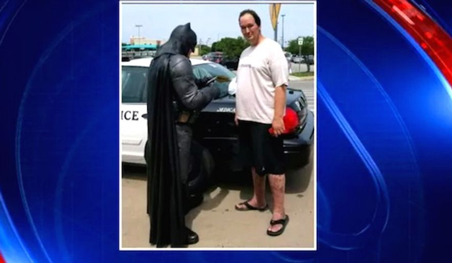 "Officer Damon Cole from Fort Worth, Texas, was entertaining children while dressed as Batman when he was called to a local Walmart to stop a shoplifting suspect, June 19, 2017. One of the items in the suspect's possession was a ""Lego Batman"" DVD. (Fox-4 Texas screenshot)"